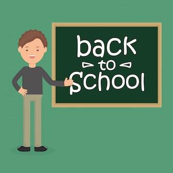 Młody męski nauczyciel z chalkboard. powrót do szkoły