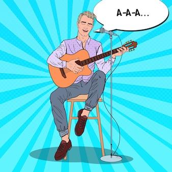 Młody mężczyzna gra na gitarze