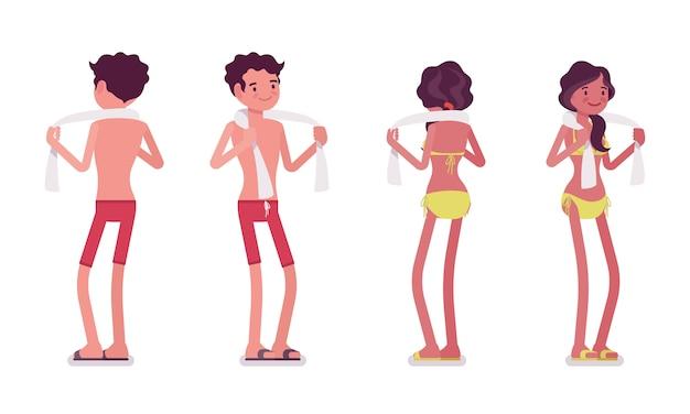 Młody mężczyzna i kobieta w stroju plaży latem, stojąc