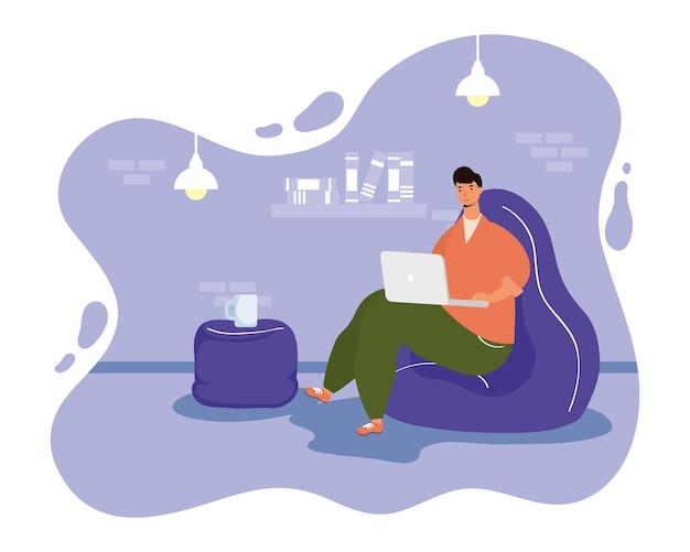 Młody mężczyzna mężczyzna za pomocą laptopa w postaci sofy
