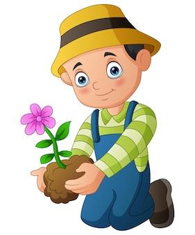 Młody mężczyzna sadzący kwiat na białym tle