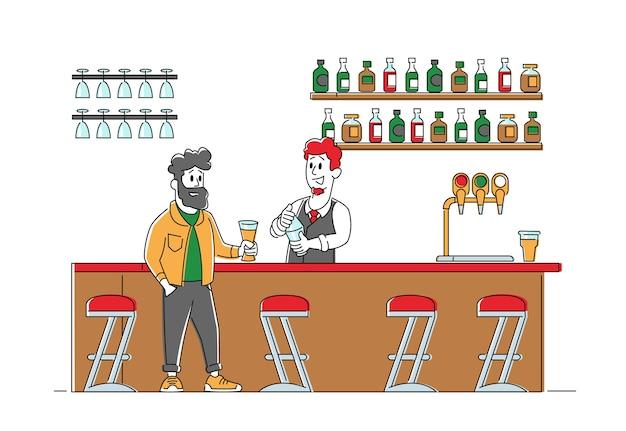 Młody mężczyzna siedzi w pubie, zamawiając napój alkoholowy