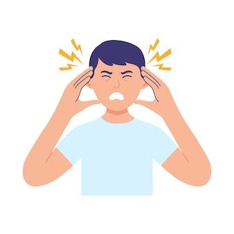 Młody mężczyzna trzyma głowę z powodu choroby lub stresu