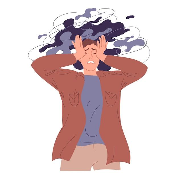 Młody mężczyzna trzyma się za głowę, przeżywając negatywne emocje, problemy psychologiczne.