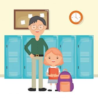 Młody nauczyciel mężczyzna z uczennicą w szkole