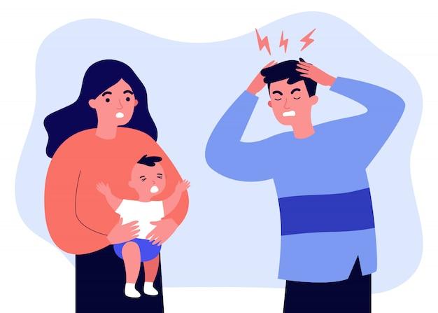 Młody ojciec zmęczony migreną z powodu płaczu dziecka