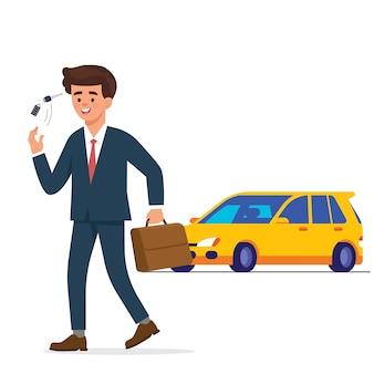 Młody pracownik chodzić i grać w jego kluczowym samochodzie