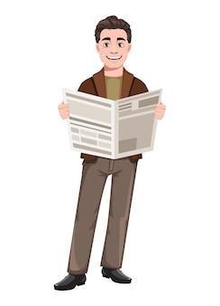 Młody przystojny biznesowy mężczyzna trzyma gazetę