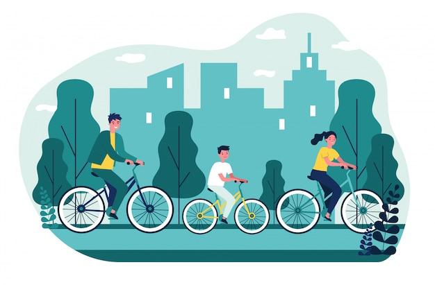 Młody rodzinny kolarstwo z miastem na tle