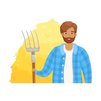 Młody rolnik w kraciastej koszuli z stogiem siana w rękach. okres zbiorów. uprawa zbóż i hodowla zwierząt. rolnictwo na własne potrzeby.