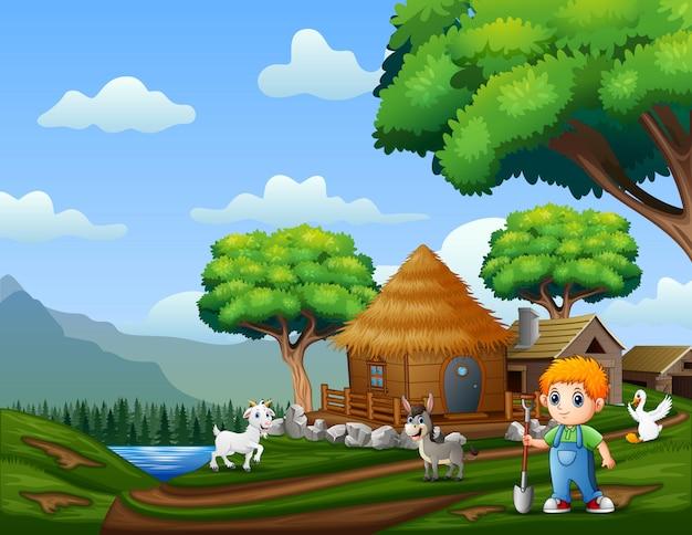 Młody rolnik ze zwierzętami na ziemi uprawnej