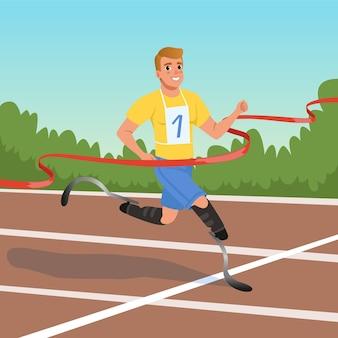 Młody sprinter z protezami nóg biorący udział w zawodach biegowych