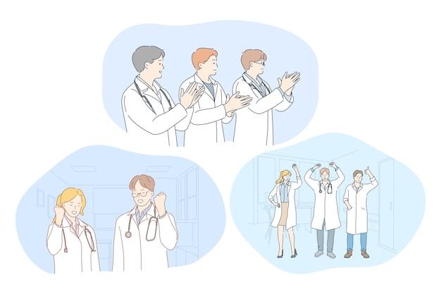 Młodzi lekarze w białym mundurze pokazujący pomyślne osiągnięcia