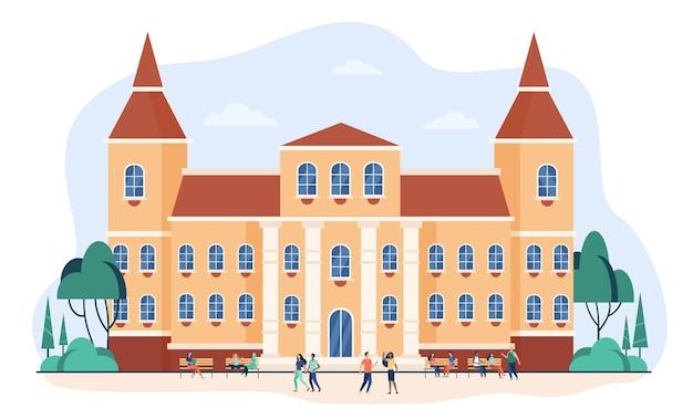 Młodzi ludzie chodzą przed płaską ilustracją kolegium lub uniwersytetu