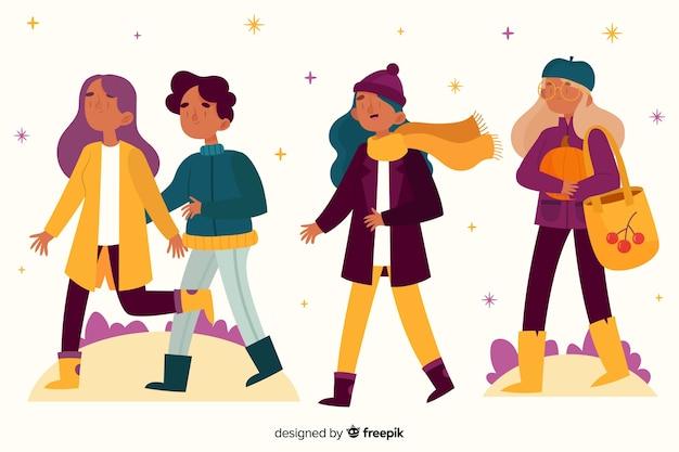 Młodzi ludzie chodzą w parku