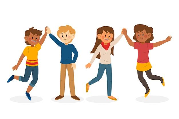 Młodzi ludzie dają piątkę ilustracji paczce
