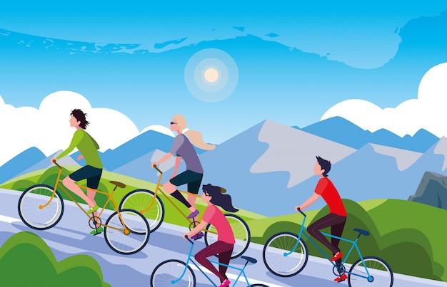 Młodzi ludzie jadący rowerem w krajobraz górski na drodze