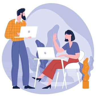 Młodzi ludzie, mężczyzna i kobieta biorą udział w spotkaniu biznesowym w biurze