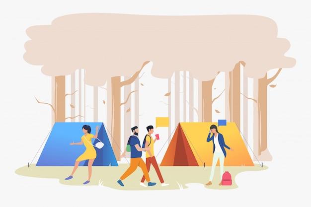 Młodzi ludzie na kempingu w ilustracji drewna