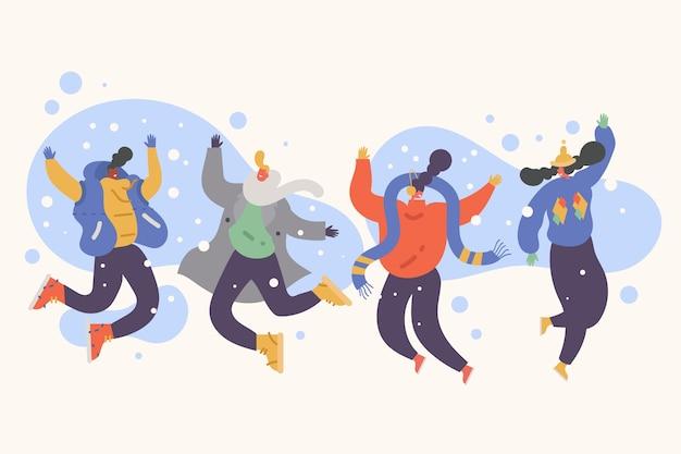 Młodzi ludzie noszący ubrania zimowe skoki