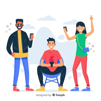 Młodzi ludzie posiadający smartfony