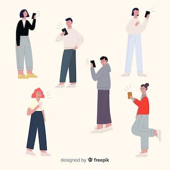 Młodzi ludzie trzymający smartfony