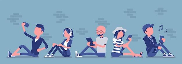 Młodzi ludzie z gadżetem. zróżnicowane siedzenie grupowe przy użyciu smartfona, tabletu do obsługi wiadomości, poczty e-mail, połączeń wideo, aplikacji społecznościowych, robienia selfie. ilustracja wektorowa z postaciami bez twarzy