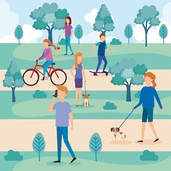 Młodzi ludzie z psami w parku