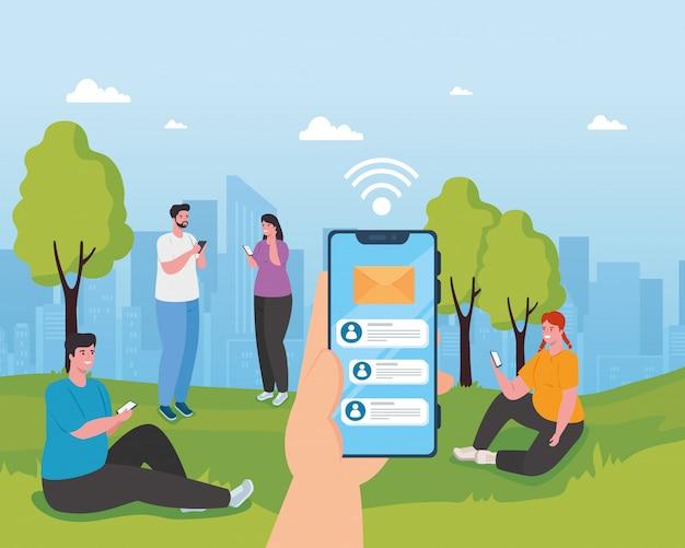 Młodzi ludzie za pomocą smartfonów na zewnątrz, mediów społecznościowych i koncepcji technologii komunikacyjnych