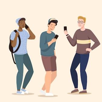 Młodzi ludzie za pomocą zestawu smartfonów