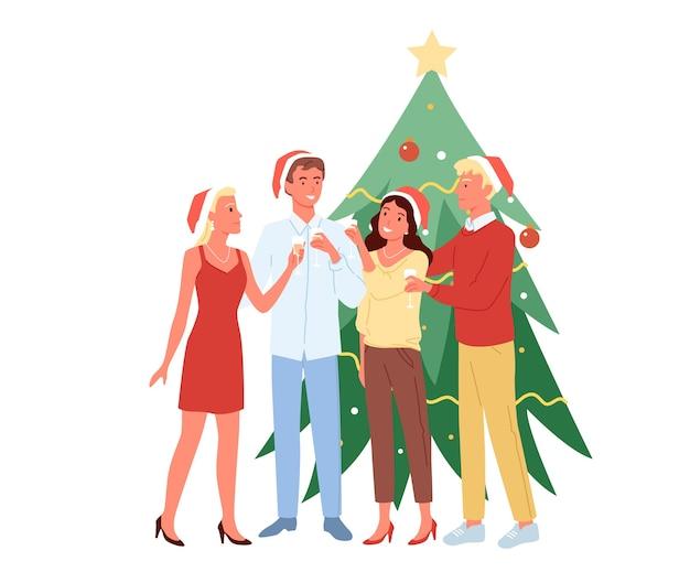 Młodzi mężczyźni i kobiety bawią się razem, wigilijne przyjęcie, piją szampana w świątecznych czapkach