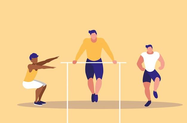 Młodzi mężczyźni uprawiający gimnastykę w barach