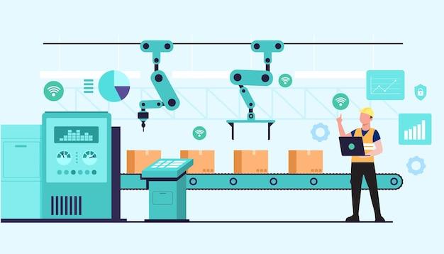 Młodzi pracownicy używają przez wi-fi z laptopa sterującego liniami przenośników automatycznej fabryki z ramionami robotów.