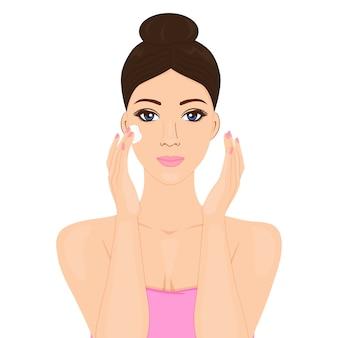 Model piękna kobieta stosuje krem na twarz