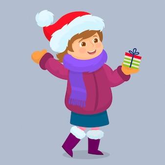 Modna dziewczynka z prezentem świątecznym,