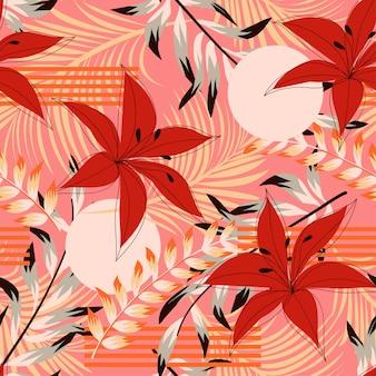 Modny abstrakcjonistyczny bezszwowy wzór z kolorowymi tropikalnymi liśćmi i kwiatami