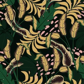 Modny bezszwowy tropikalny wzór z jaskrawymi żółtymi i zielonymi liśćmi i roślinami