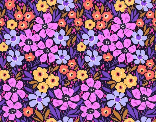 Modny kwiatowy wzór. bezproblemowy nadruk. motywy letnie i wiosenne. kolorowe tło