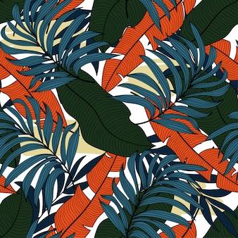 Modny tropikalny wzór z jasnozielonymi i pomarańczowymi liśćmi i roślinami