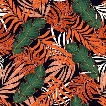 Modny tropikalny wzór z jasnymi pomarańczowymi i zielonymi roślinami i liśćmi