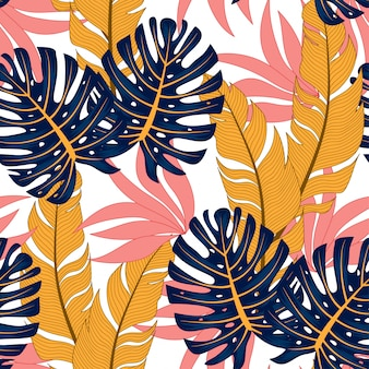 Modny tropikalny wzór z jasnymi roślinami i liśćmi na świetle.