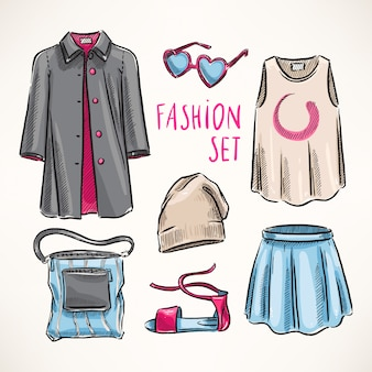 Modny zestaw z damską odzieżą i dodatkami. ręcznie rysowane ilustracji