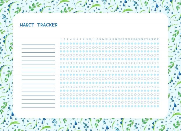 Monitorowanie nawyków na miesiąc. puste wiosenne niebieskie dzikie kwiaty, osobisty organizer z ozdobną ramą.