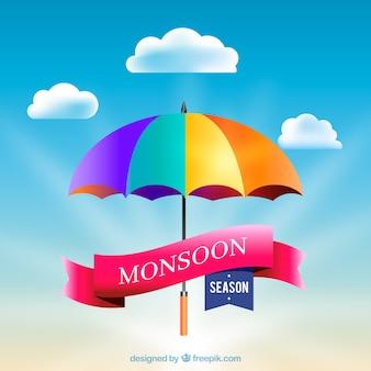 Monsunu sezonu tło z kolorowym parasolem