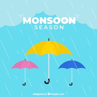 Monsunu sezonu tło z kolorowymi parasolami