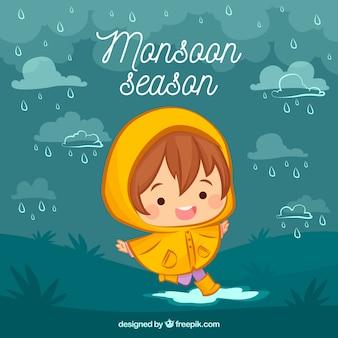 Monsunu sezonu tło z ślicznym dzieciakiem