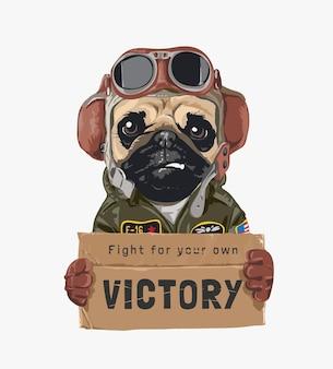 Mops pies lotnik trzyma kartonową ilustrację zwycięstwa