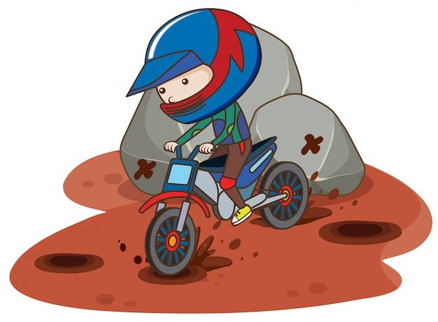 Motocross bike riding in mud
