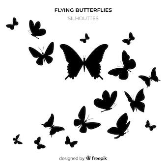 Motyl sylwetki rój tło