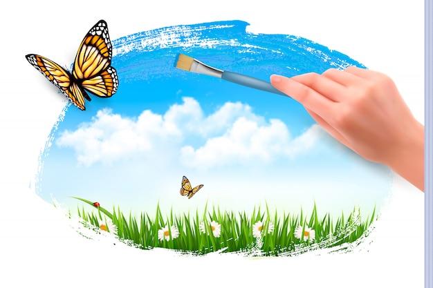 Motyle i ręka z pędzlem.